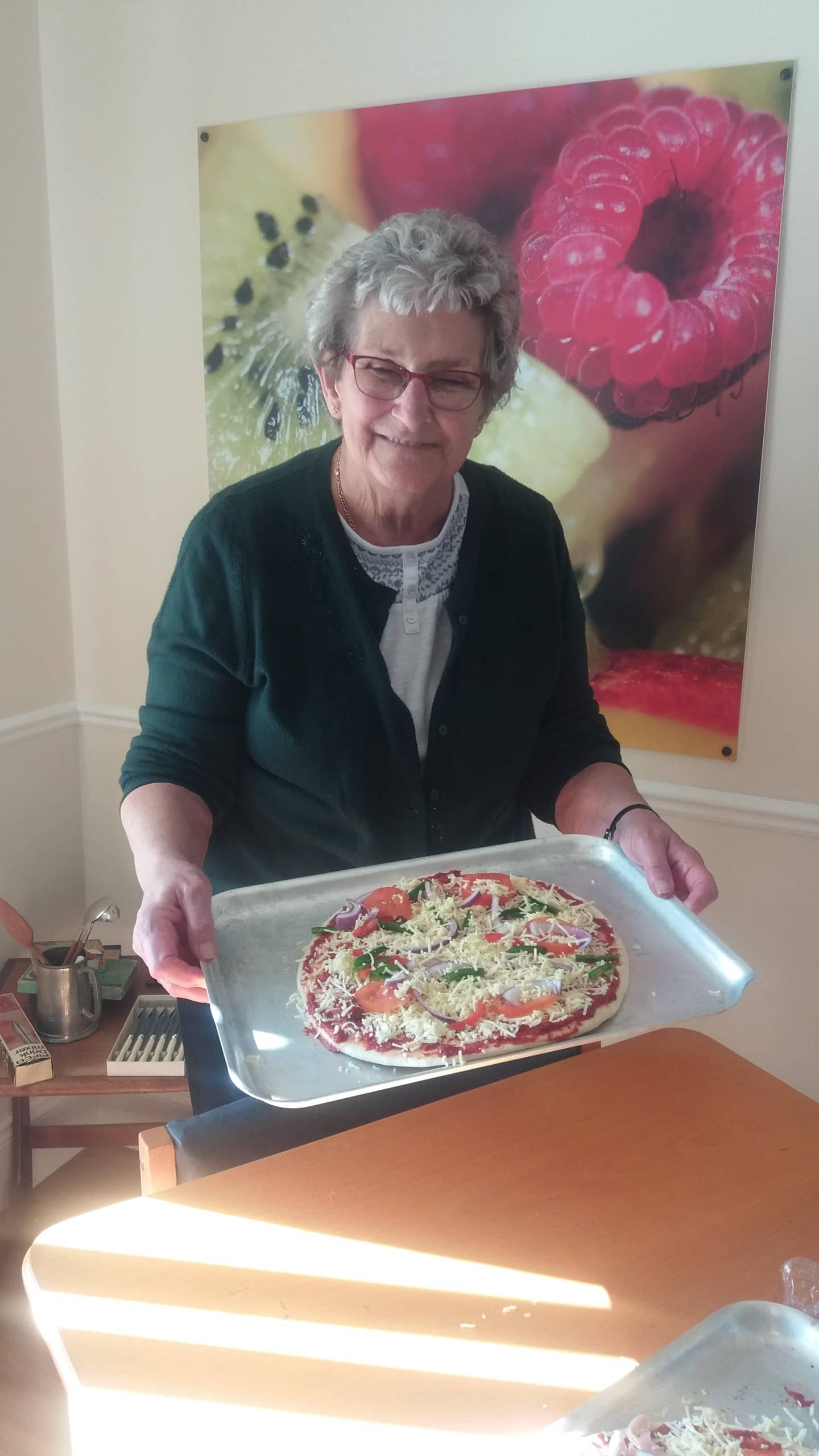 Resident ready to cook her pizza.