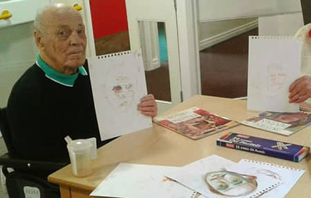 Resident Frank, with one of his drawings.