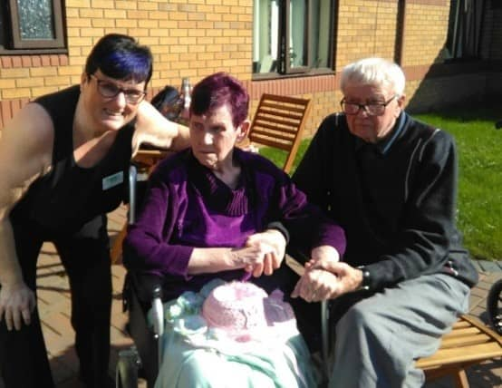 Residents enjoying the dementia friendly garden