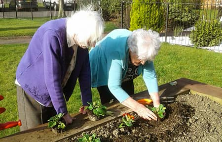 Residents Betty and Doreen enjoying a spot gardening.