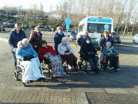 Residents and their families outside the National Glass Centre