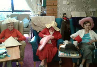 Three residents at Lymewood Court, sporting three different hats on International Hat Day