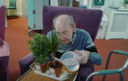 Residents looking after his new houseplant.