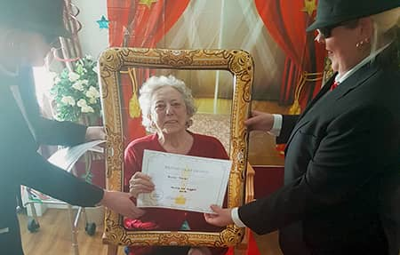 Resident gladly winning an award.