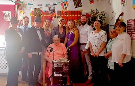 The staff at Meifod & Vicarage with a resident, during their award evening.
