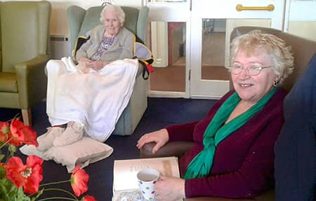 Residents enjoy reading some poetry.