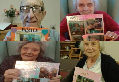 Residents showing off their new 2019 calendars.