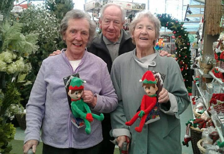 Three residents enjoying the Christmas decorations at Clays Garden Centre