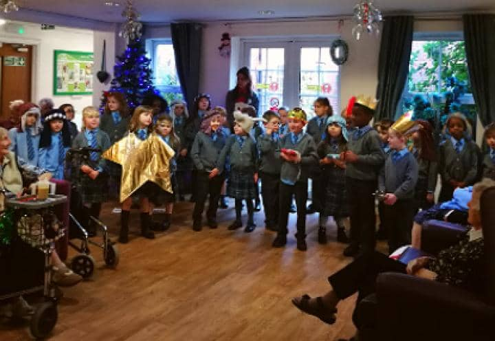 School children performing the Nativity for residents at Eaton Court