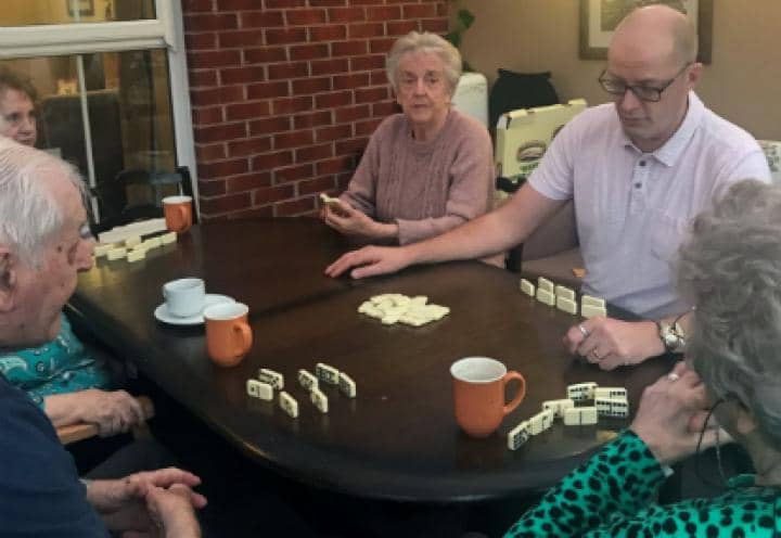 Residents enjoying a game of dominoes