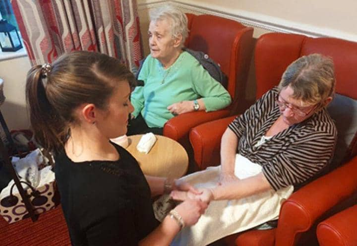 Residents enjoying being pampered.