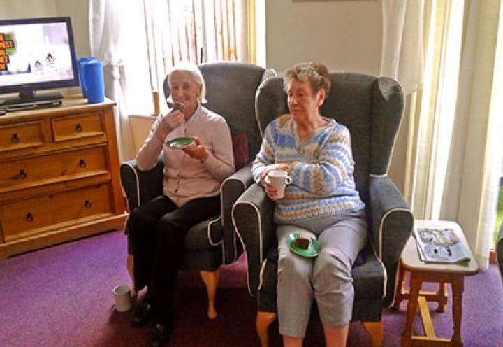 Residents at Archers Park enjoying some coffee and cake.