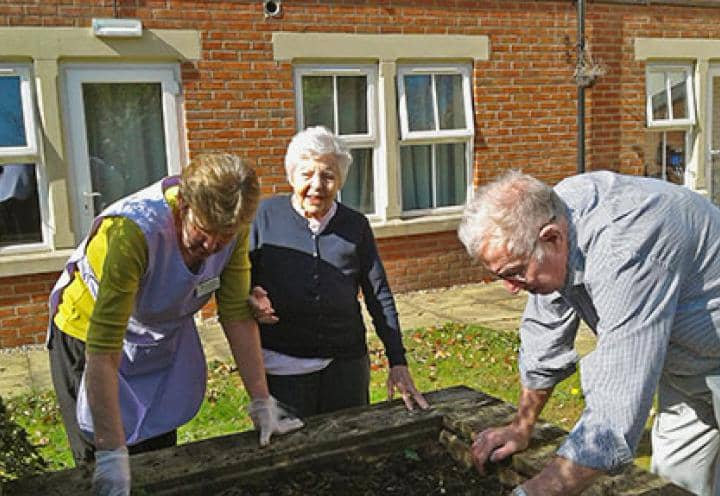 Left to right: Linda Newman - Activities Coordinator, Mary - Resident, Lesley - Resident. Out Gardening