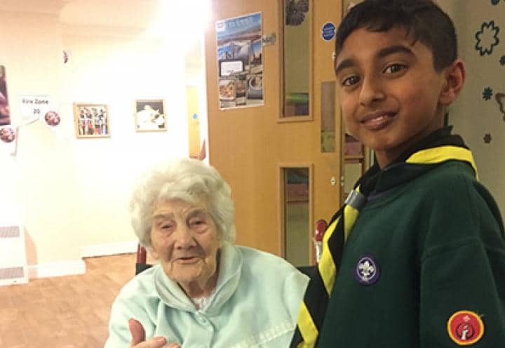 Scout visiting residents at St Helens Hall & Lodge