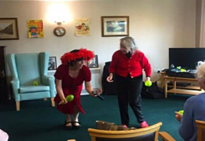 Sandra the entertainer showing residents a few dance moves.