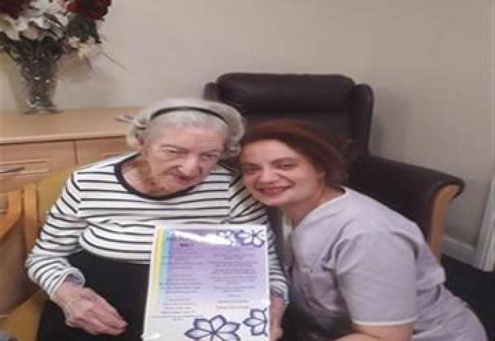 Resident Betty and Activities Coordinator, Rachael Pierre, with a copy of the poem!