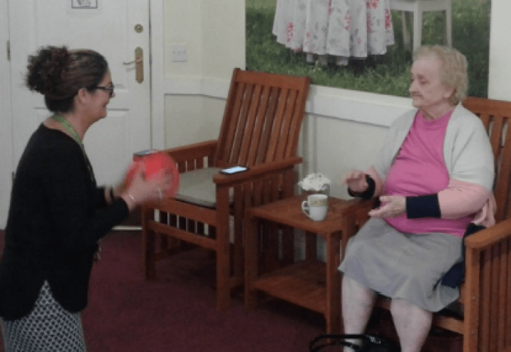Ruth and the care home manager throwing a ball