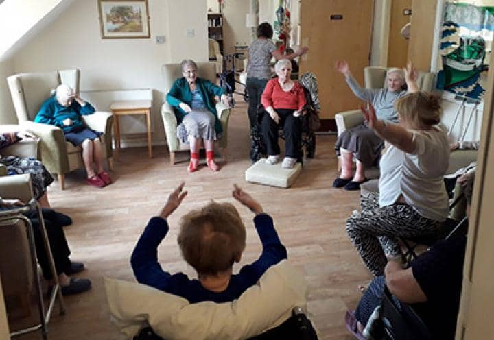 Residents at Island Court Care Home enjoying their exercise class.