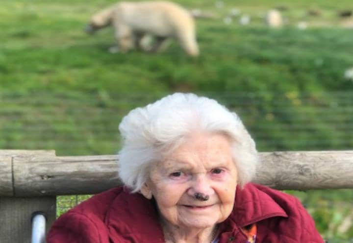 Eaton Park resident posing for a picture with a polar bear