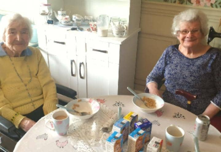 Residents taste testing the cereals