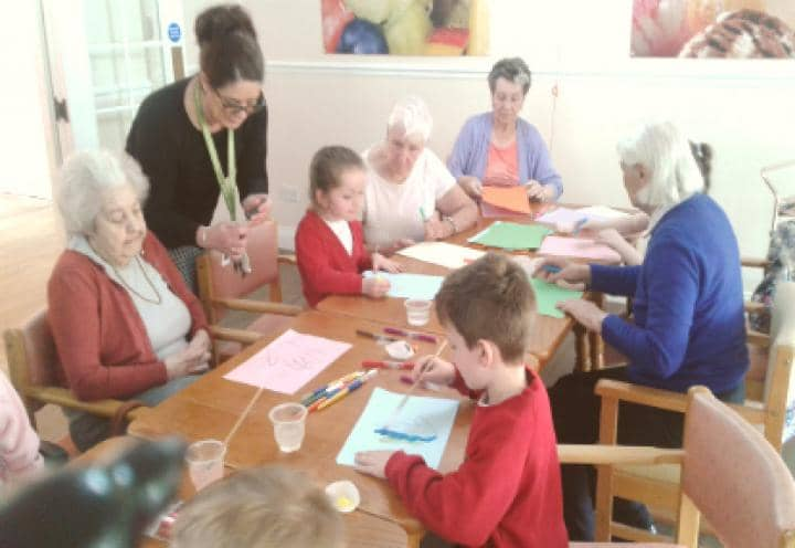 Residents and Children painting together