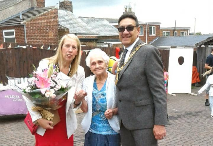 Oldest resident at the home poses with the Mayor and Mayoress