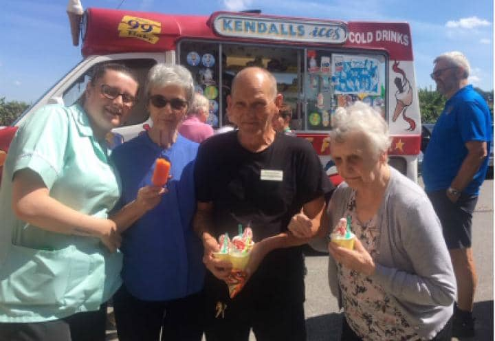 Residents and staff with their ice creams