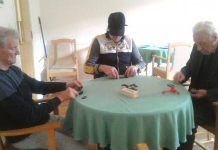 residents playing dominos