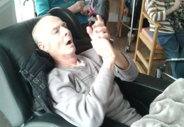 Resident John clapping along to the music