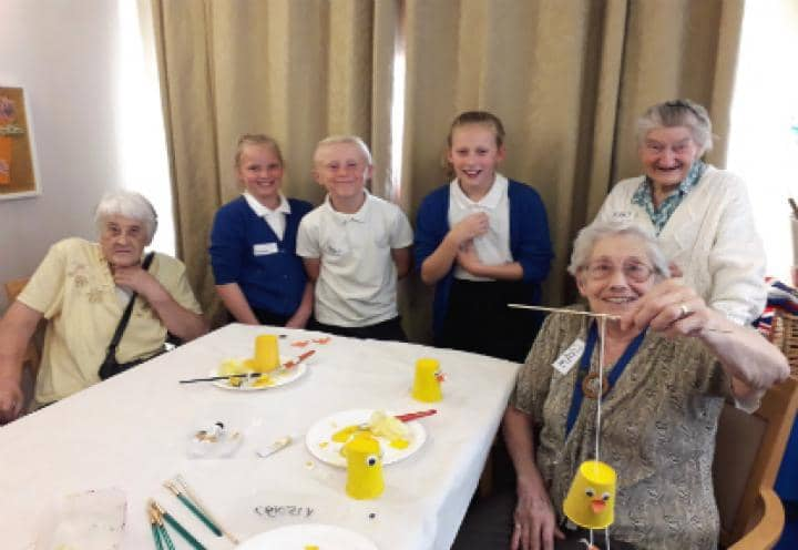 The children and residents showing off their artwork