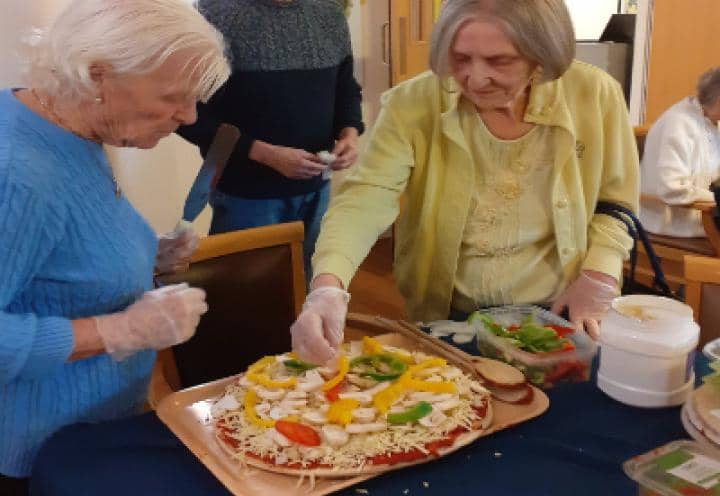 Residents making pizzas
