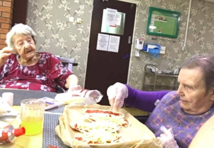 Residents making their pizza