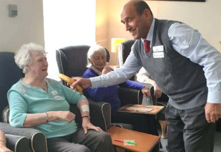 resident laughing with vistor from barnes park bowls team
