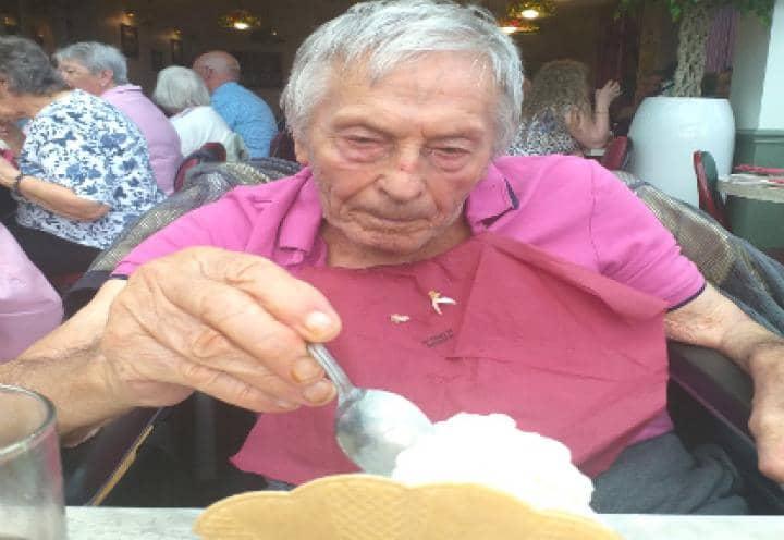 resident enjoying his ice cream