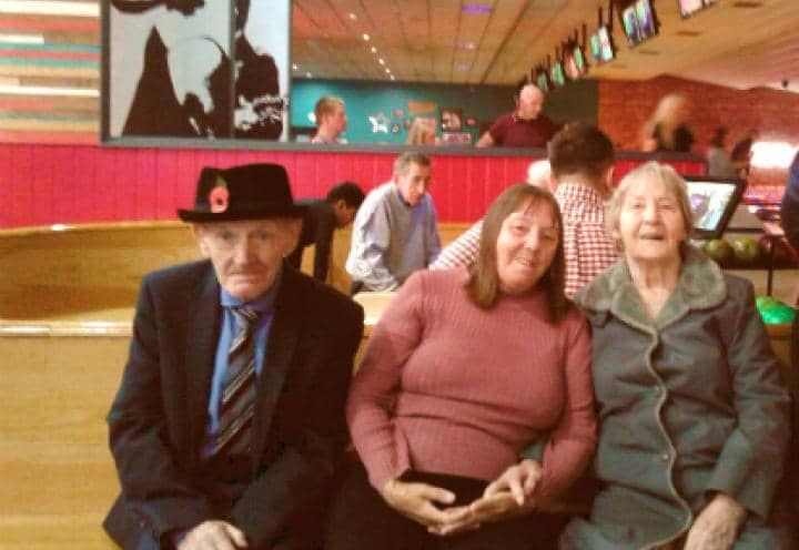 residents smiling away at the bowling alley