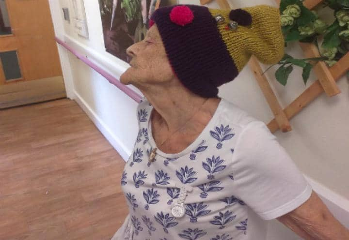 Resident modelling the hat that she knitted