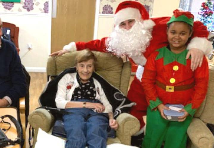 resident with santa and the elf.