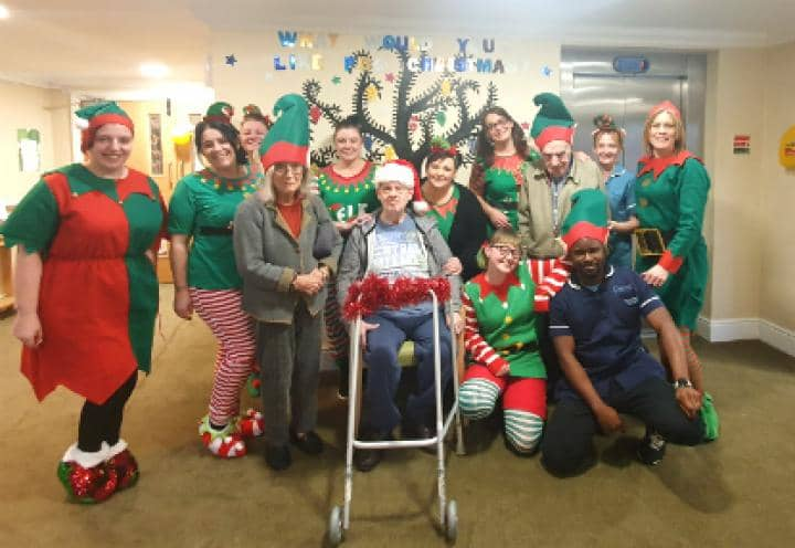 residents and staff dressed up for elf day.