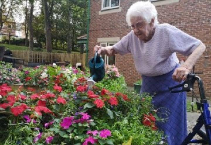 Eckington Court Care Home resident watering the flowers