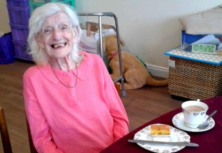 ethel smiling with her afternoon tea.
