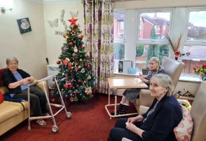 residents sat near the Christmas tree.
