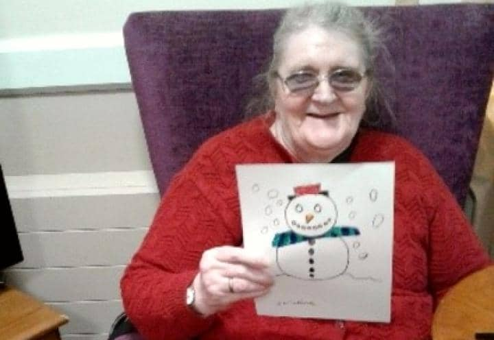 resident with her snowman colouring.